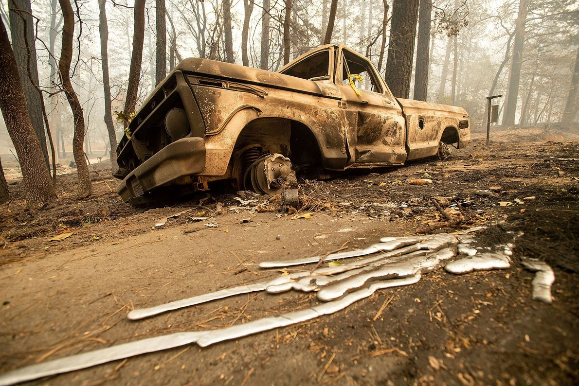 A burned pick-up truck rests on Pearson Road in Paradise, California. Not much is left in ...