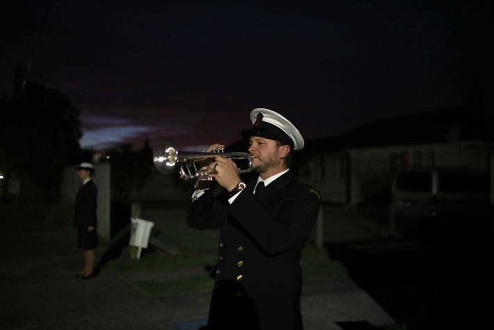 "Ordinary Musician Orson Paine, of the Royal New Zealand Navy Band, plays ""The Last Post"" bugle ..."