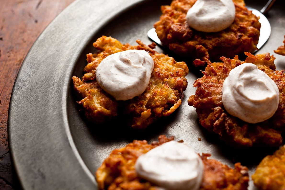 Latkes, or potato pancakes, are a traditional dish for Hanukkah. Deep fried and topped with sour ...