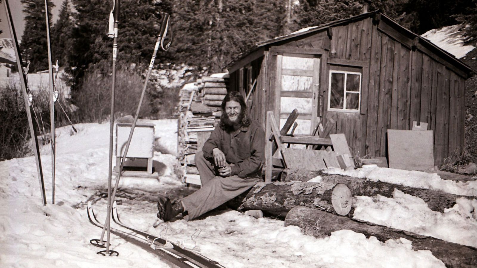 billy sits in front of the mining shack where he lived from 1973 to 1980. Although ...
