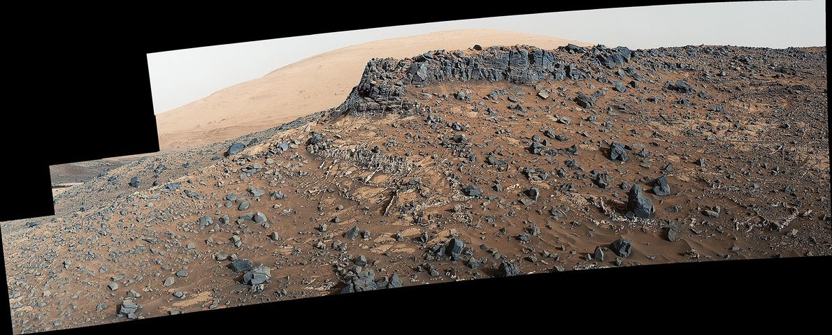 A mosaic view from the Mars rover Curiosity shows prominent mineral veins in the terrain near …