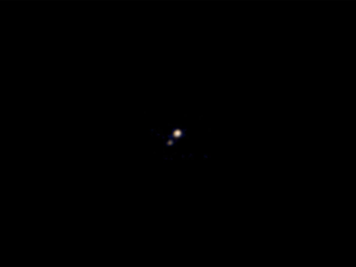 On April 9, 2015, the New Horizons spacecraft took this photograph of Pluto and Charon from ...