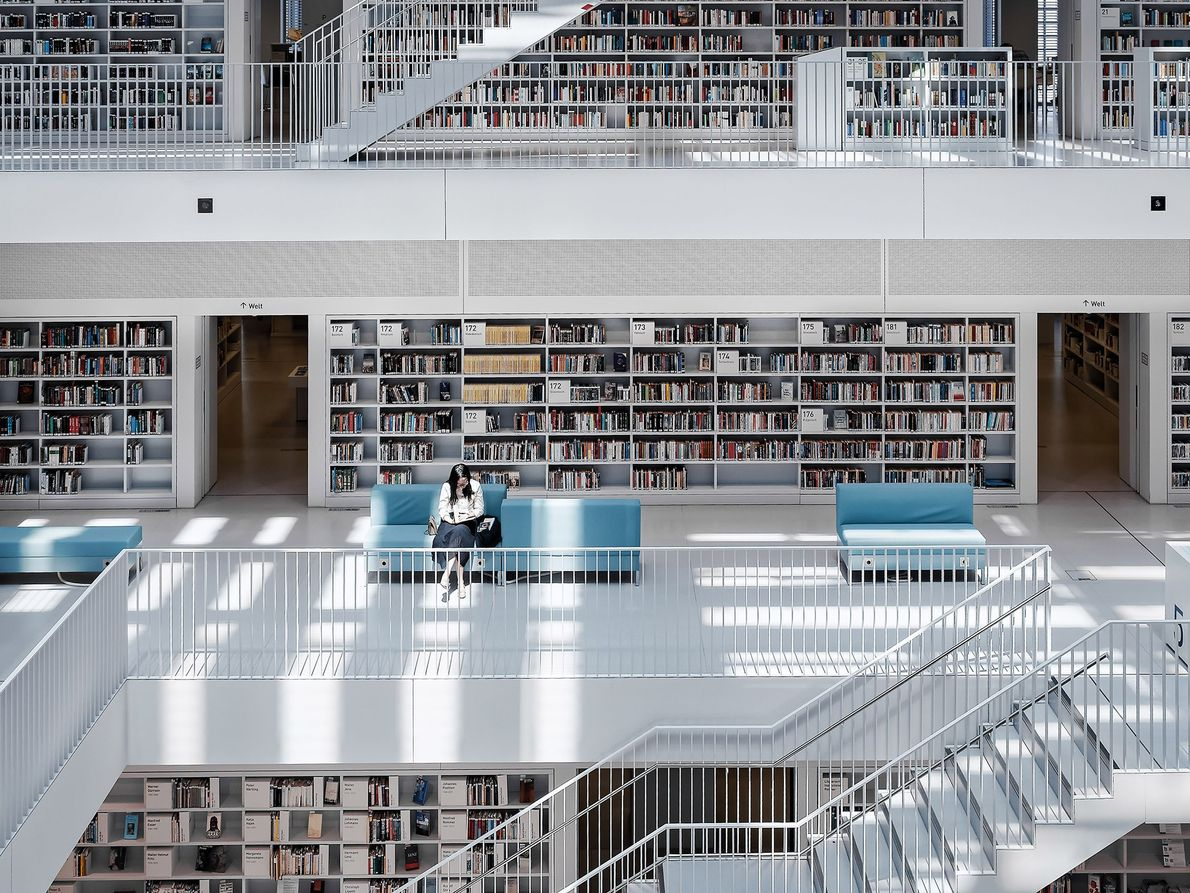 Skylights illuminate a reader in the Stuttgart City Library in Stuttgart, Germany. From the outside, the ...