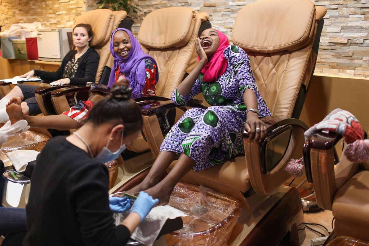 Ya Kaka laughs while getting a pedicure in New York City. When she thinks back to ...