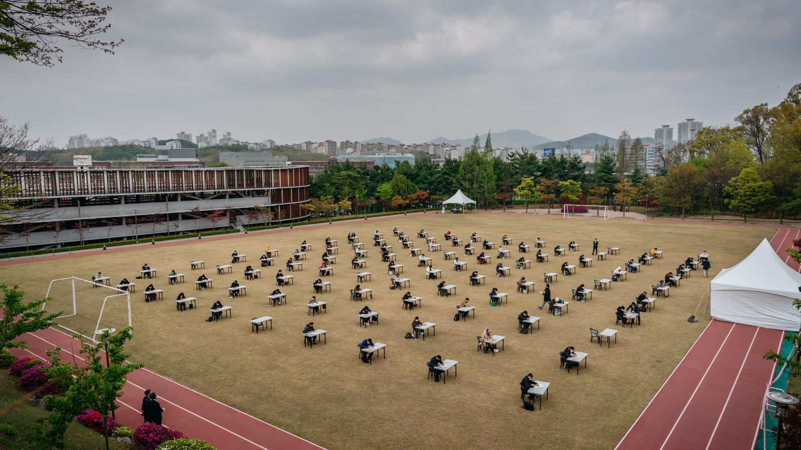Following the advice from the South Korean government, public and private institutions introduced exams that adhere ...