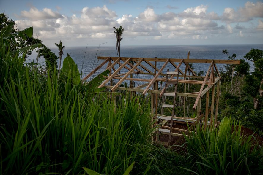 Eight months after Hurricane Maria hit Dominica, a house is under construction in the Kalinago territory ...
