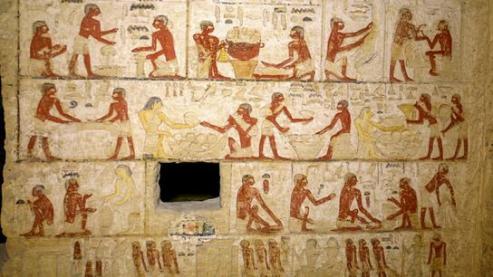 Painted reliefs on the walls of the tomb include these scenes of workers carrying out a ...
