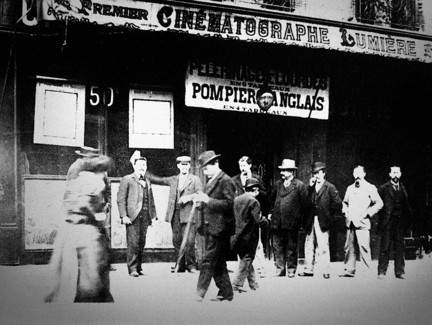 Customers gather outside a Lumière theater in France, 1897, as cinema was becoming a part of ...