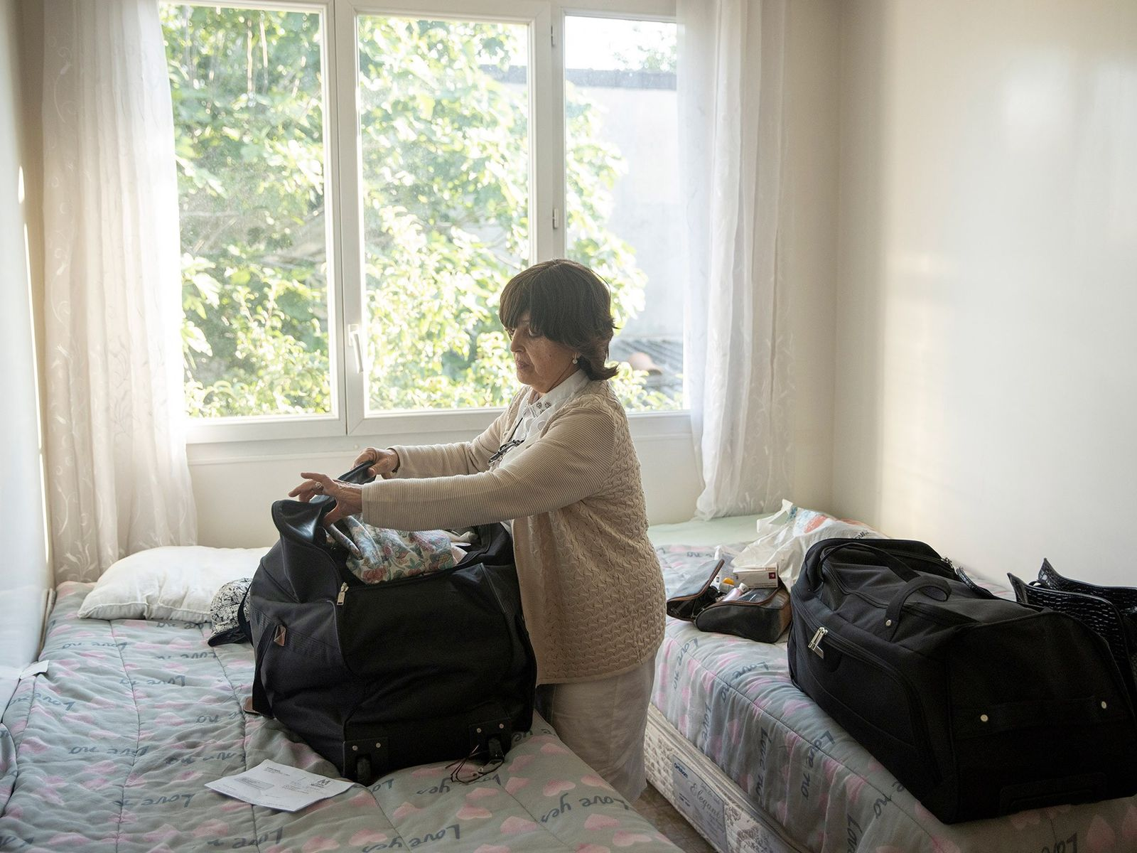 Esther Elfersi finishes packing her bags for the journey the next morning.
