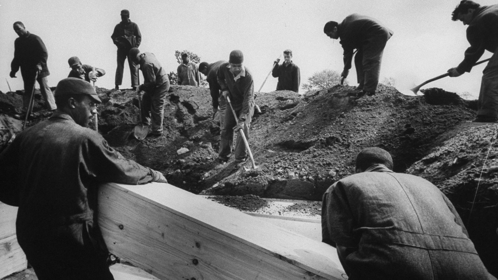 Prisoners bury unclaimed remains on New York's Hart Island in 1963. The public cemetery has been ...