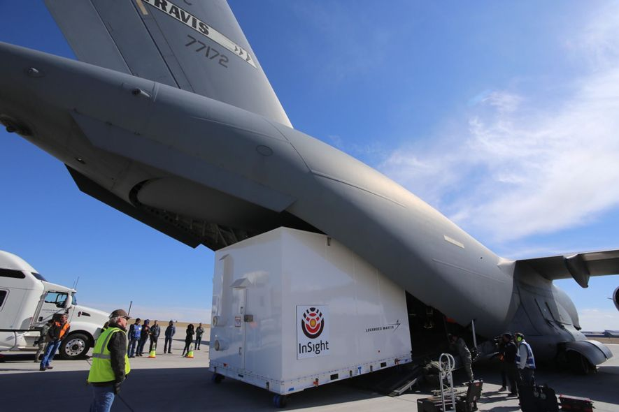 NASA's InSight spacecraft gets loaded into a cargo plane at Buckley Air Force Base in Colorado ...