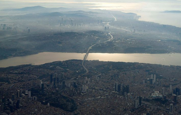 The narrow Bosporus is seen from a plane window over Istanbul.
