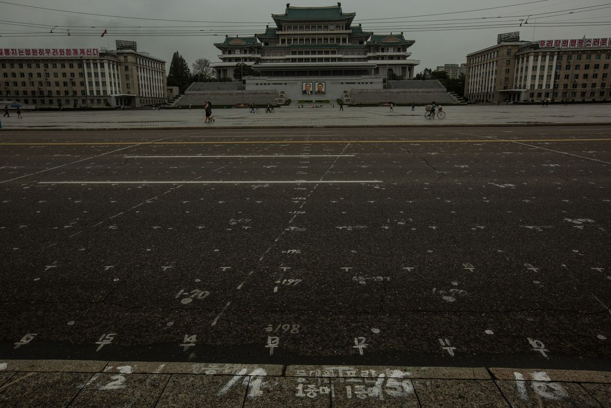 A grid painted on the street in Pyongyang's Kim Il Sung Square to mark where participants ...