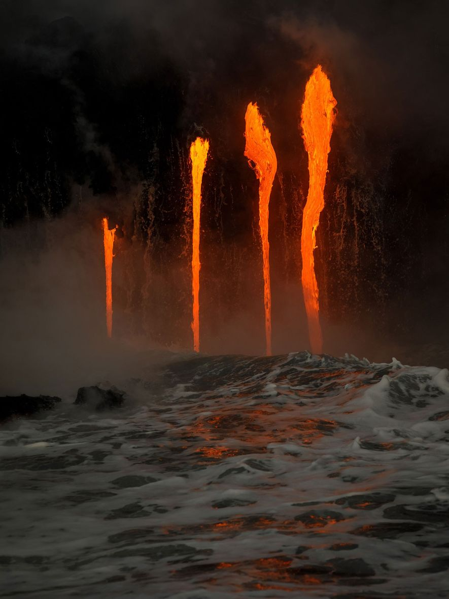 Lava flows into the water from the Kīlauea Volcano, Hawaii.