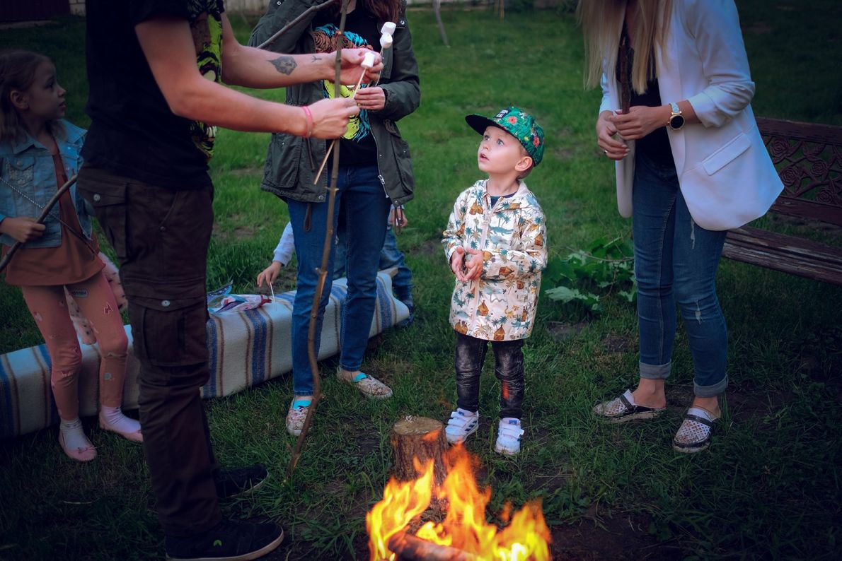 Your Shot photographer Ewelina Strzelczyk documented this scene around a bonfire as roasted marshmallows are being ...