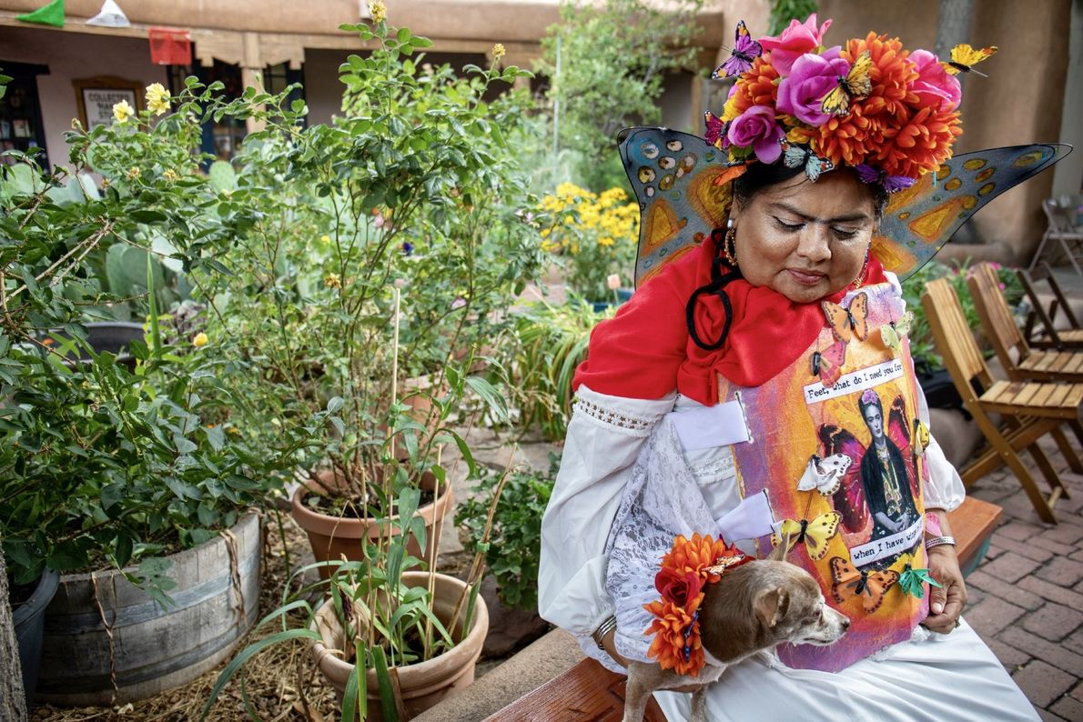"""""""Gina Two Feathers holds her dog Koko Frida during the Frida Kahlo Fiesta in Old Town ..."""