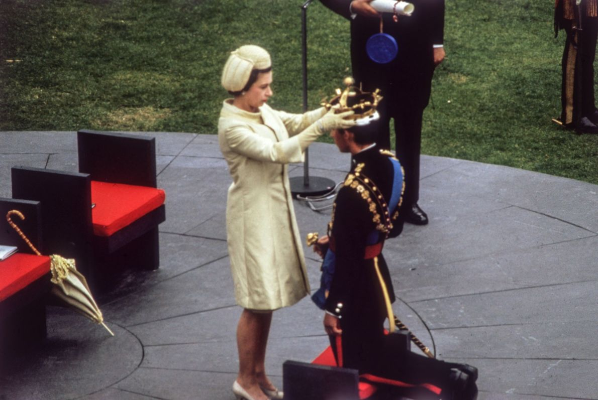 Queen Elizabeth II crowns her son Charles as the Prince of Wales during an investiture ceremony ...