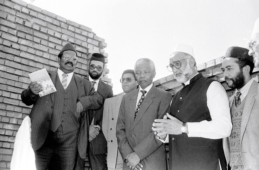 Then President of African National Congress Nelson Mandela (middle) visits to the predominantly Muslim area of ...