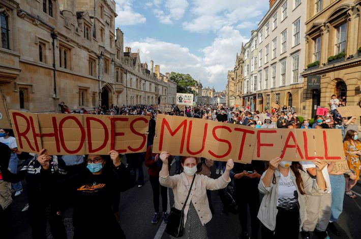 Demonstrators at the University of Oxford, holding placards during a protest arranged by the 'Rhodes Must ...