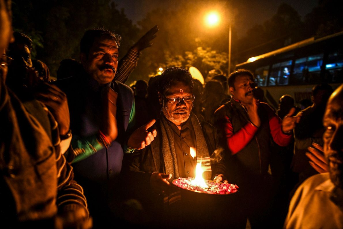 Hindu activists participate in a candlelight vigil outside the Kerala state house as they protest against ...