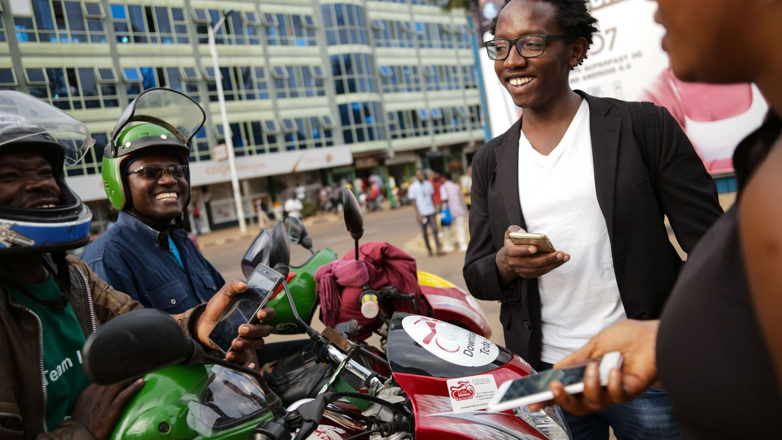 Peter Kariuki, a founder of SafeMotos, interacting with his drivers in downtown Kigali.
