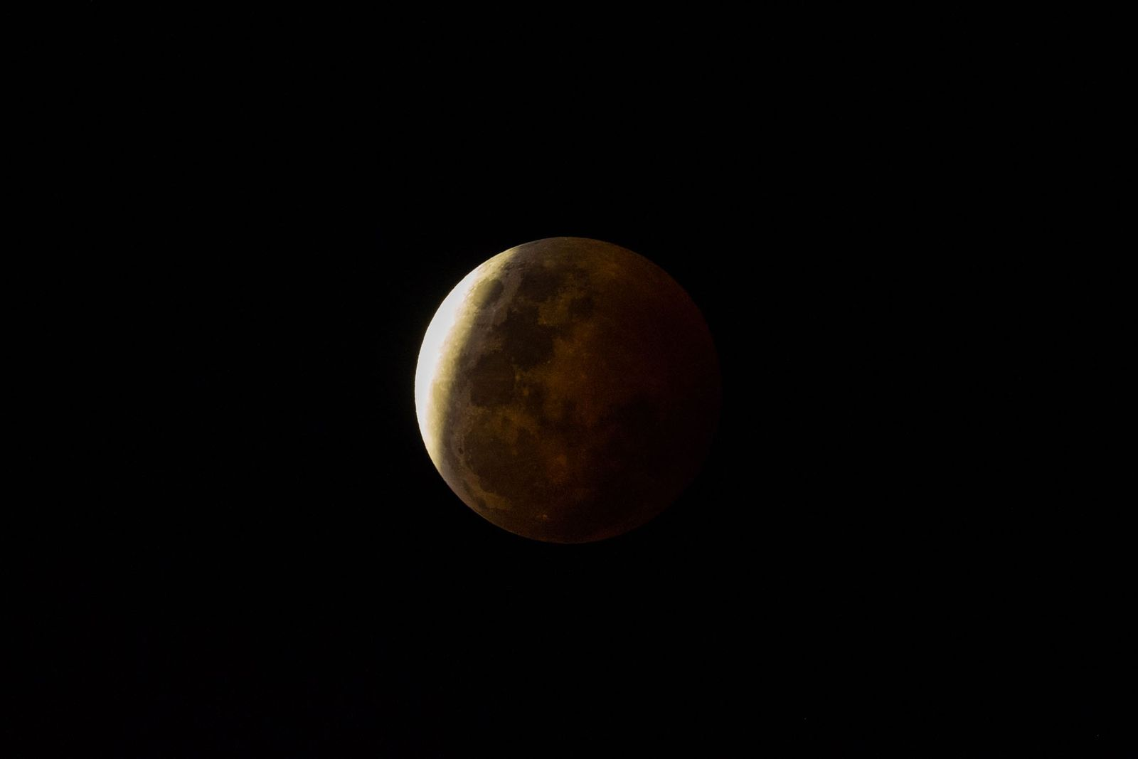 A shadow falls across the face of the moon during a lunar eclipse.