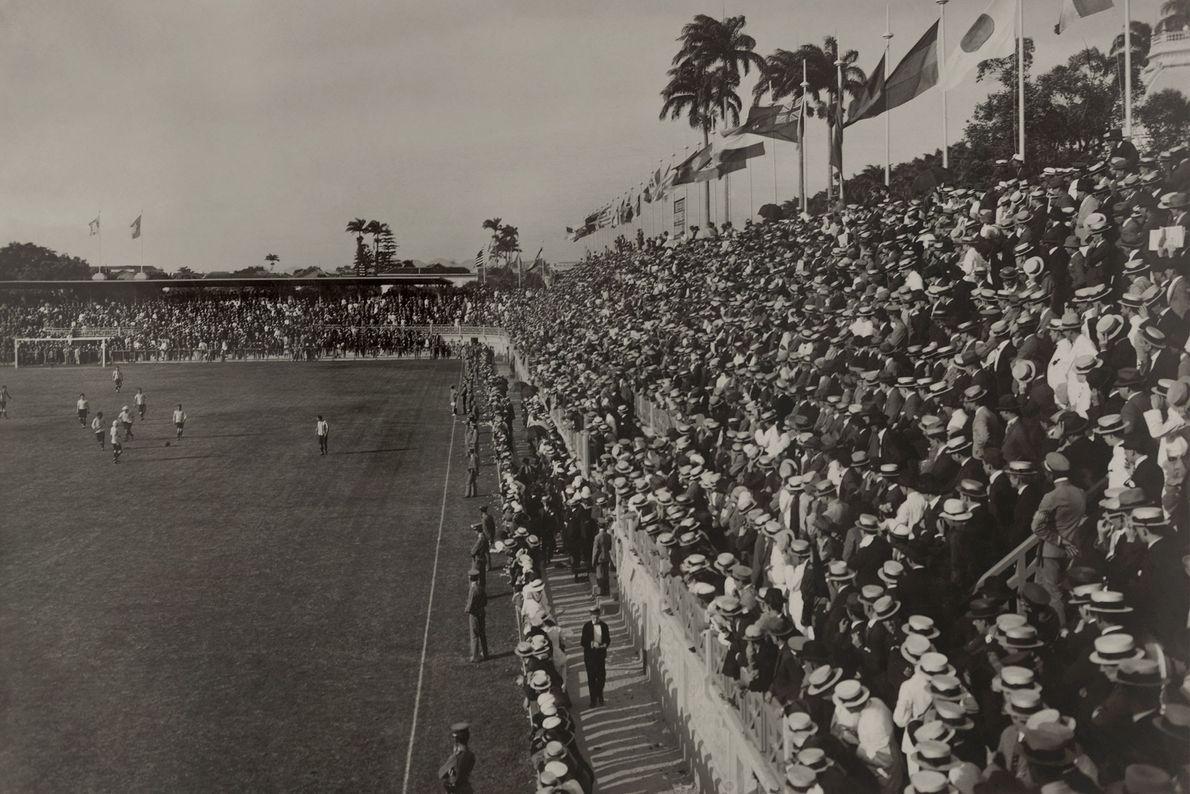 A crowd watches a Brazilian football, or soccer, match in Rio de Janeiro in 1920.