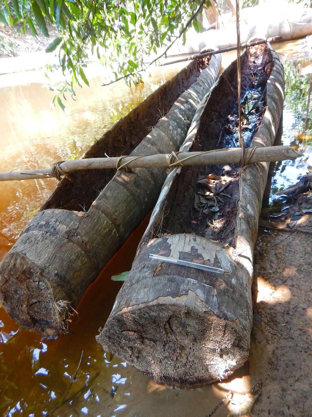 A pair of crude canoes used by the Flecheiros on the banks of the Jutai River.