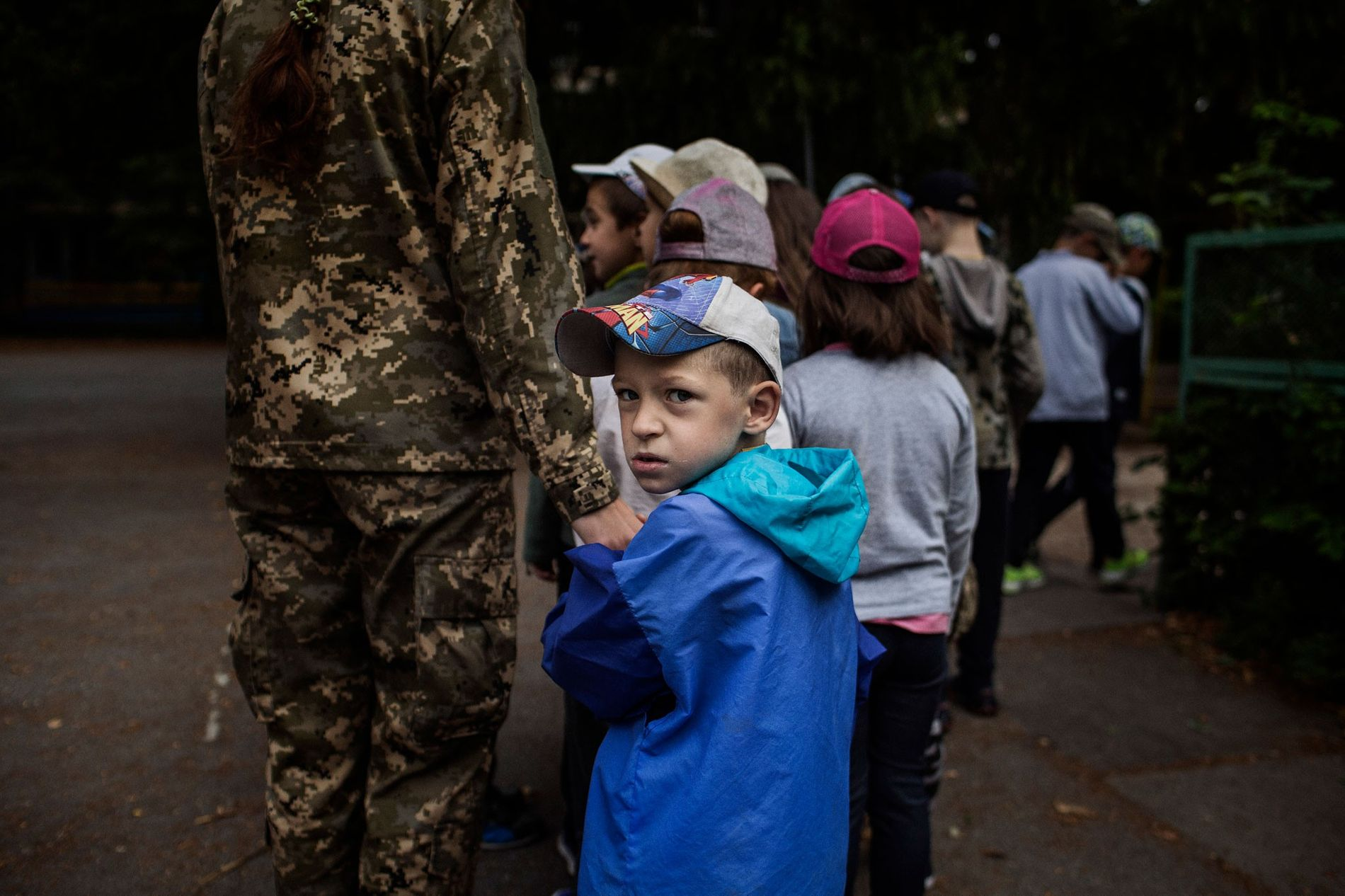 A volunteer instructor guides the youngest group of LIDER, a summer camp for children aged six ...