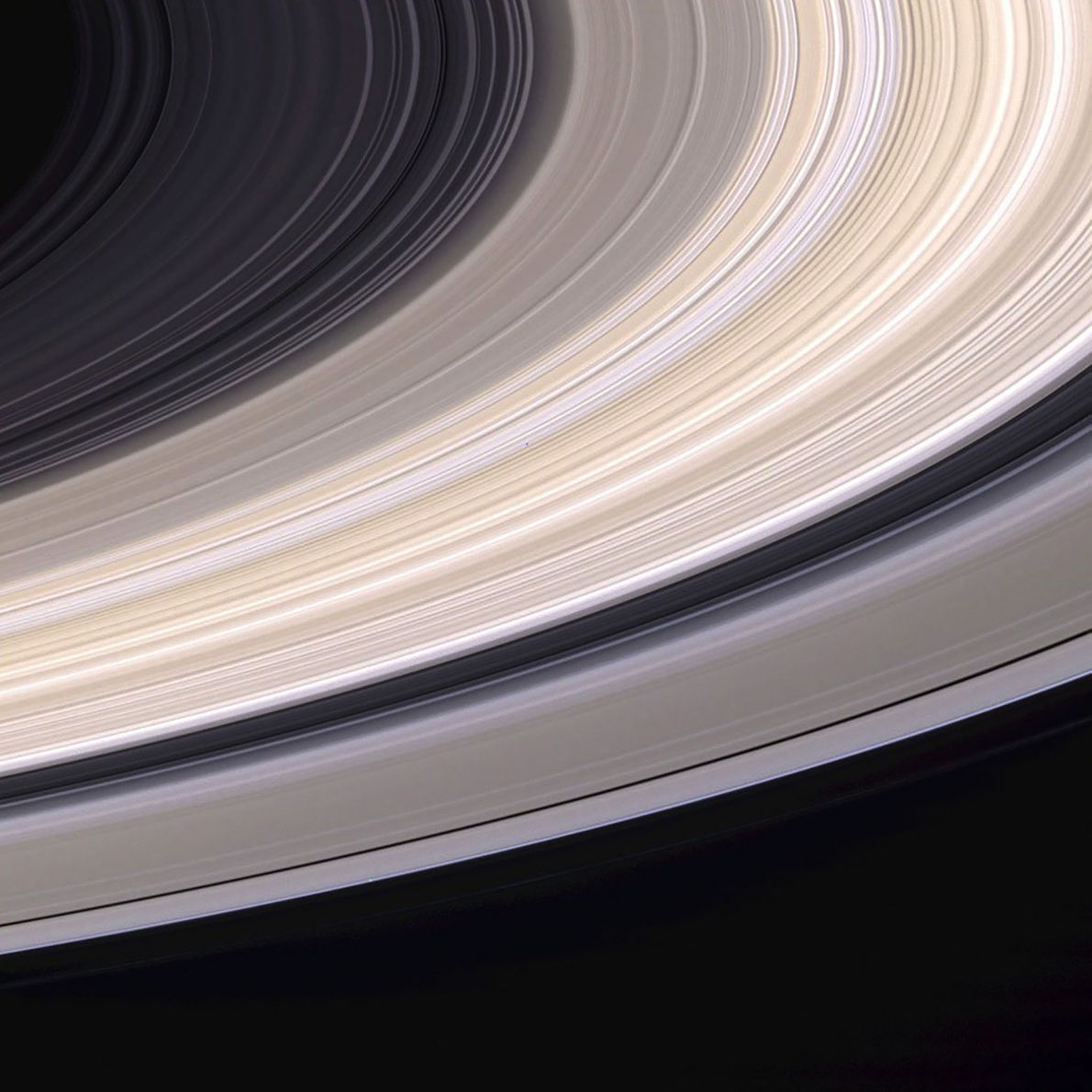 Nine days before it entered Saturn's orbit, Cassini captured this exquisite natural-color view of the planet's ...