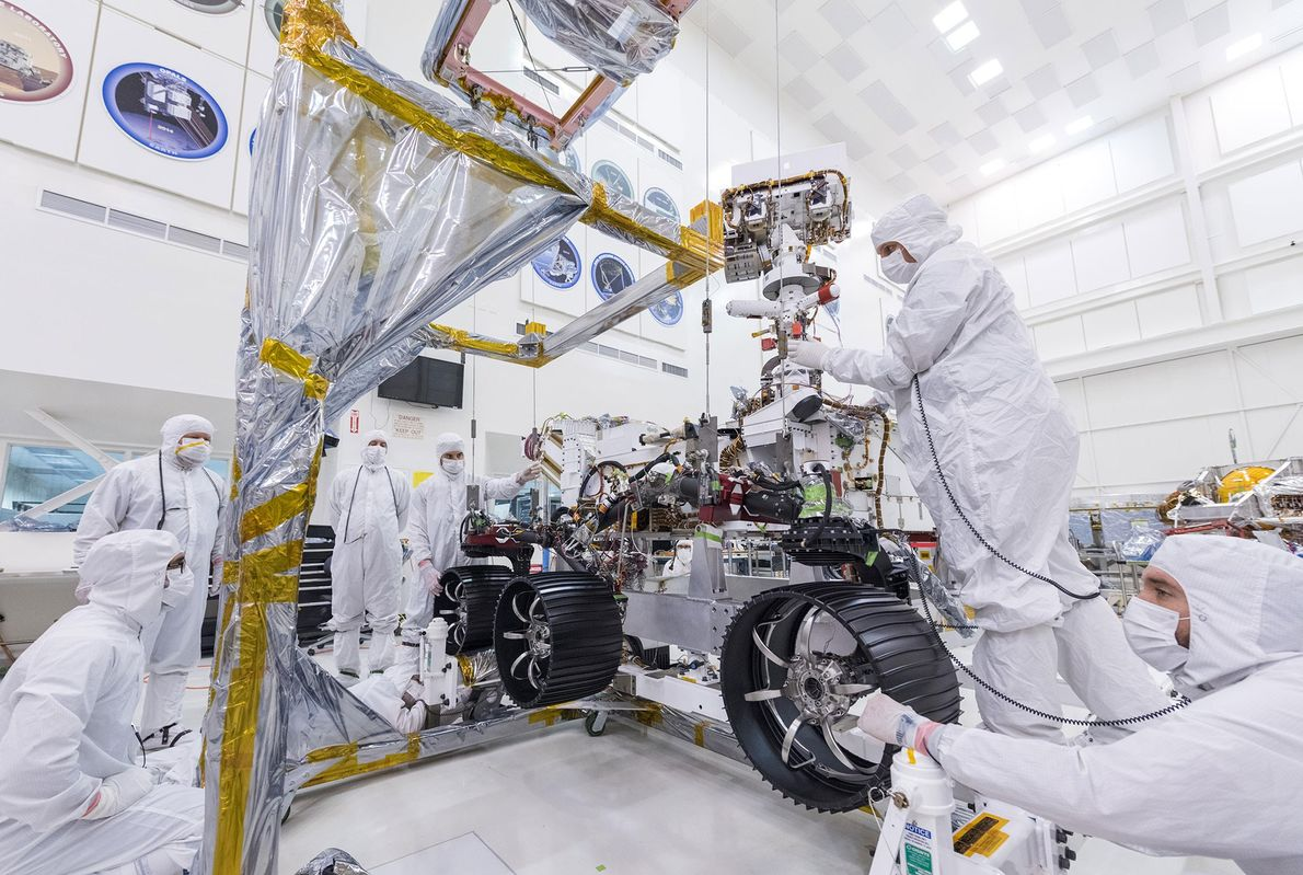 On June 13, technicians at NASA's Jet Propulsion Laboratory installed wheels on the right side of ...