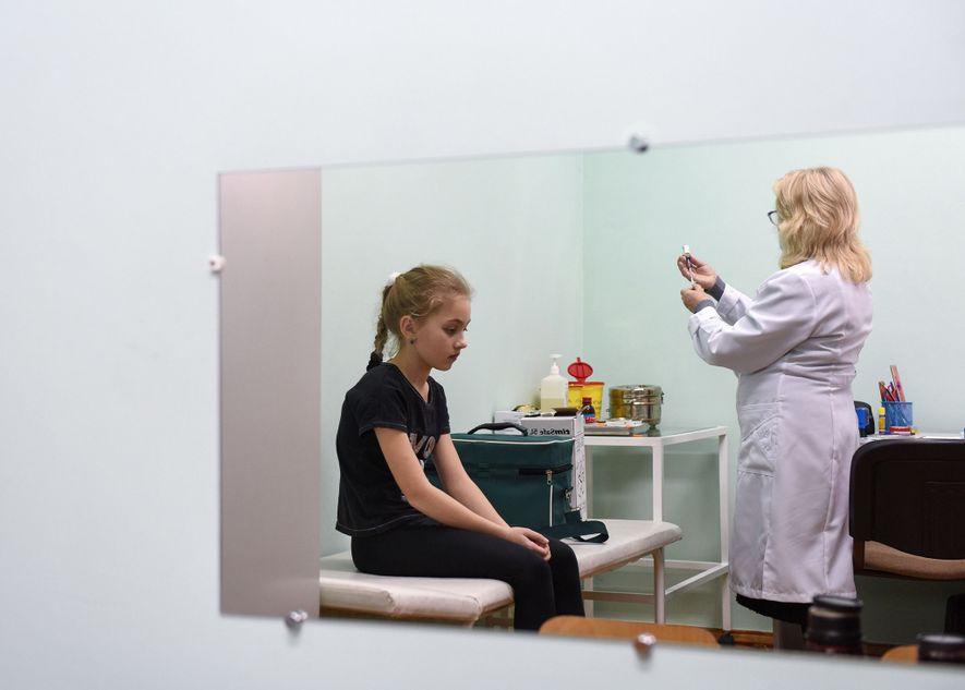 A nurse prepares a measles vaccine in a school in Lapaivka village, near the western Ukrainian ...