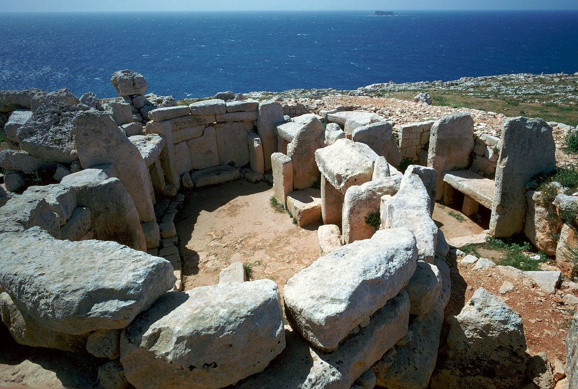 At Mnajdra Temple in Malta, the sun shines down a central corridor during the vernal equinox ...
