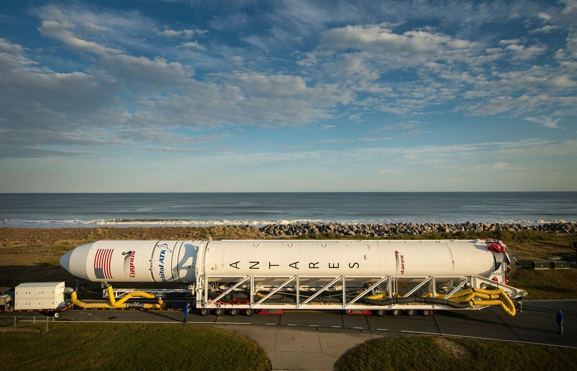 An Orbital ATK Antares rocket is rolled to launch pad on October 13, 2016, at NASA's ...