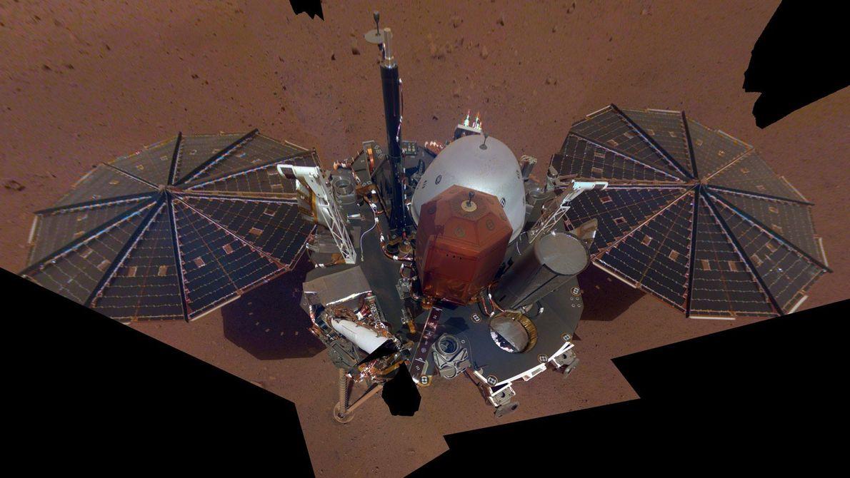 NASA's InSight Mars lander captured its first full-body selfie on Mars on December 6, 2018. The ...