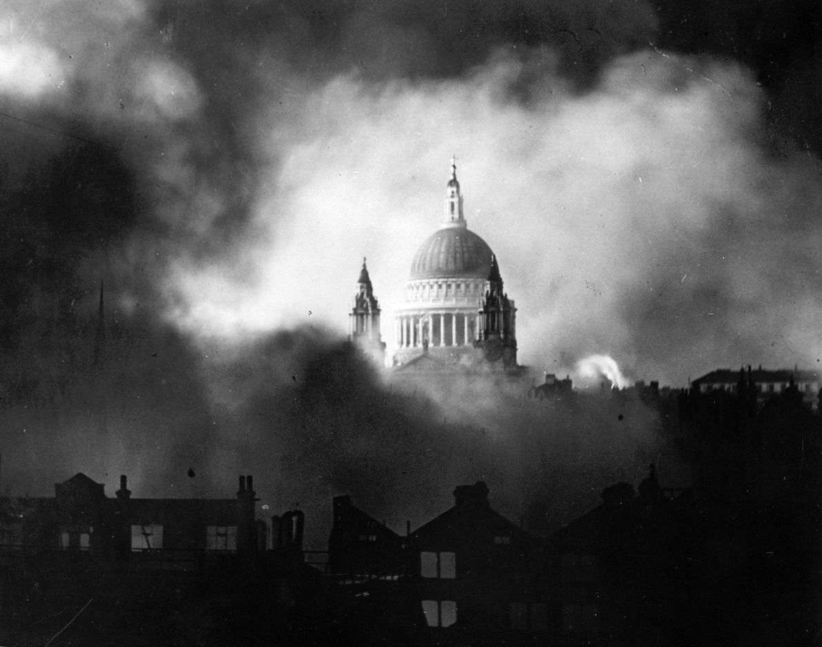 The dome of St. Paul's Cathedral peeks over smoke clouds during heavy bombing raids by the ...