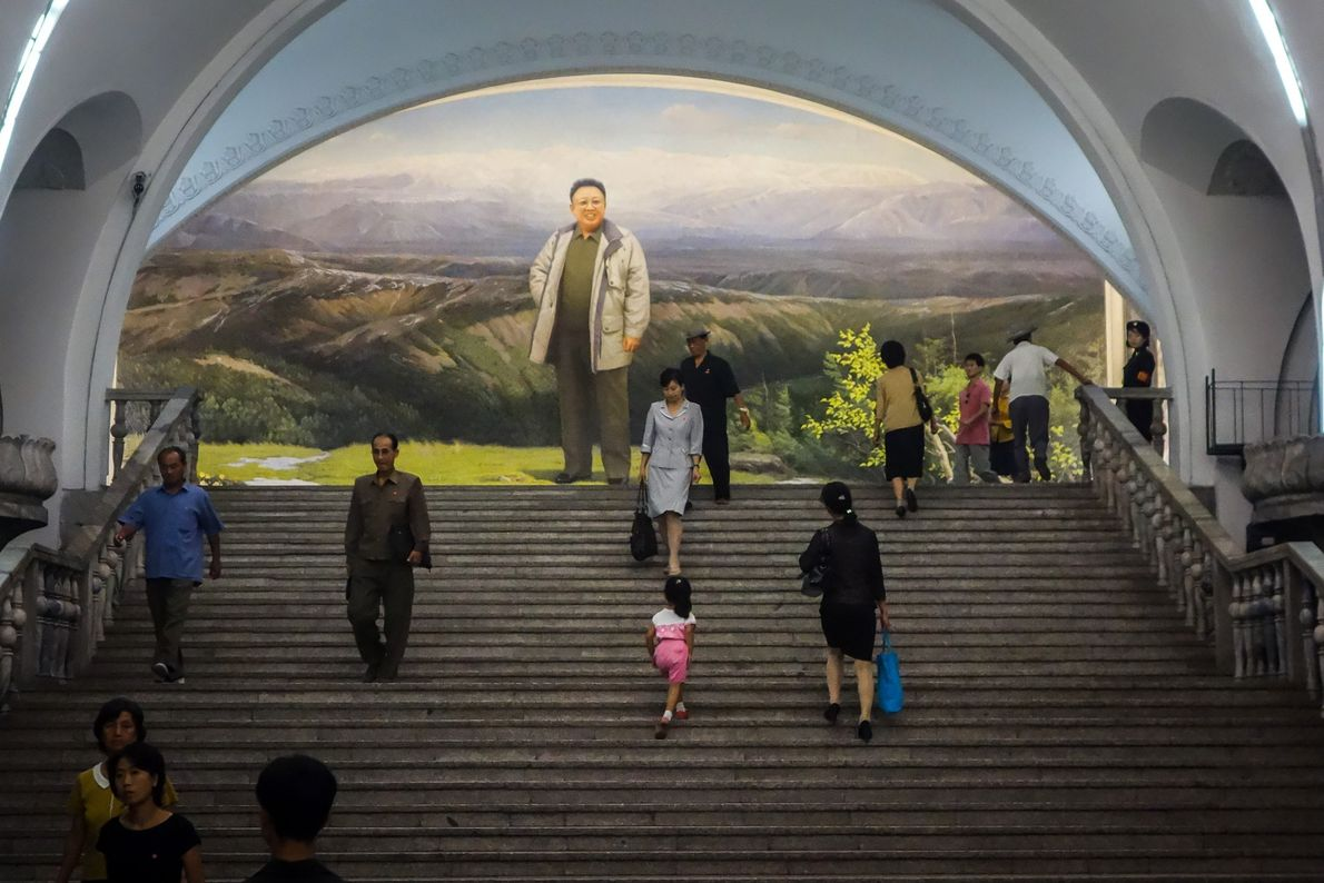 A mural in Yonggwang Station shows Kim Jong Il, Supreme Leader from 1994-2011, standing in front ...