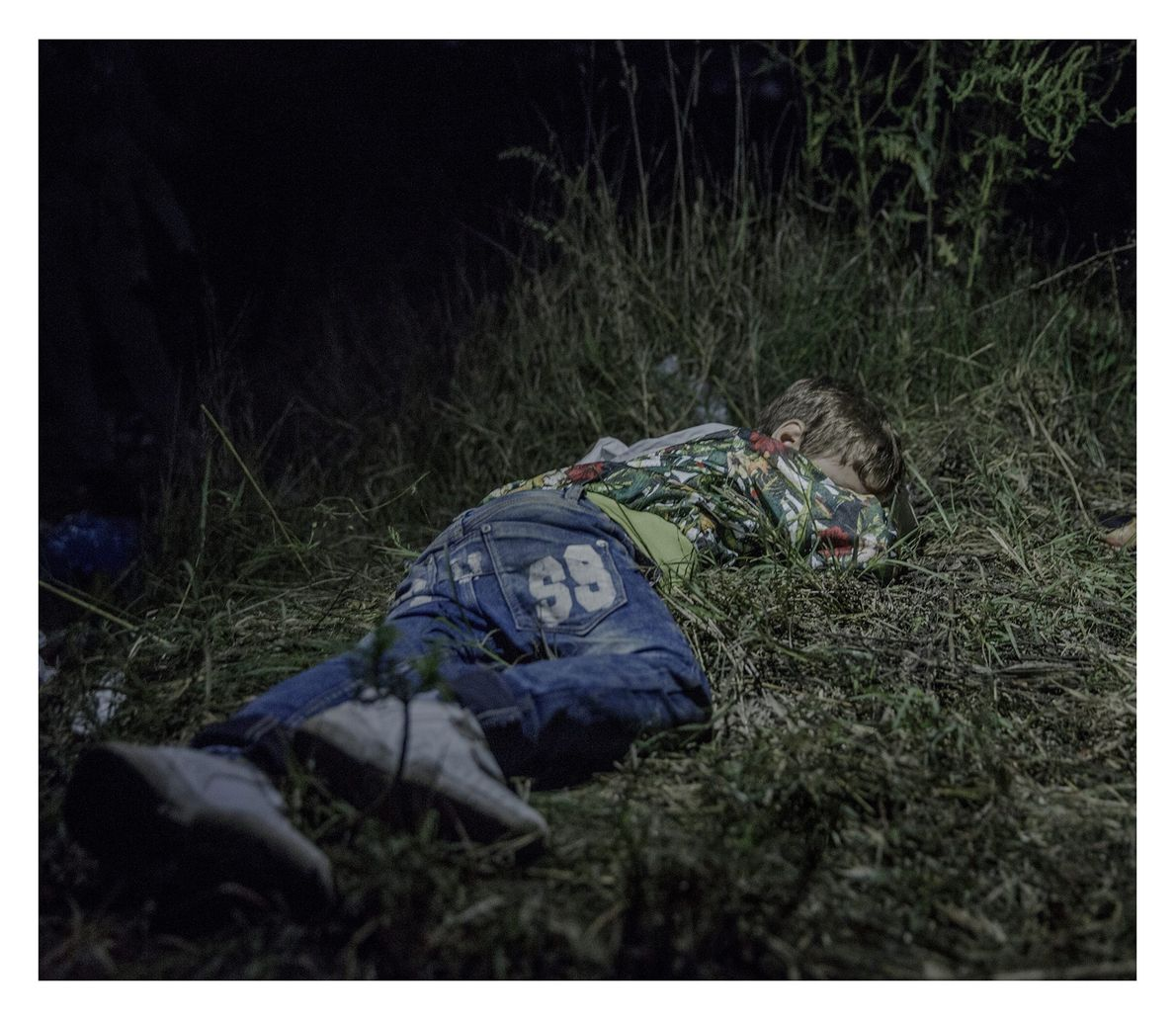 While the adults make plans to evade the authorities in Hungary, Ahmed, 6, sleeps in the ...
