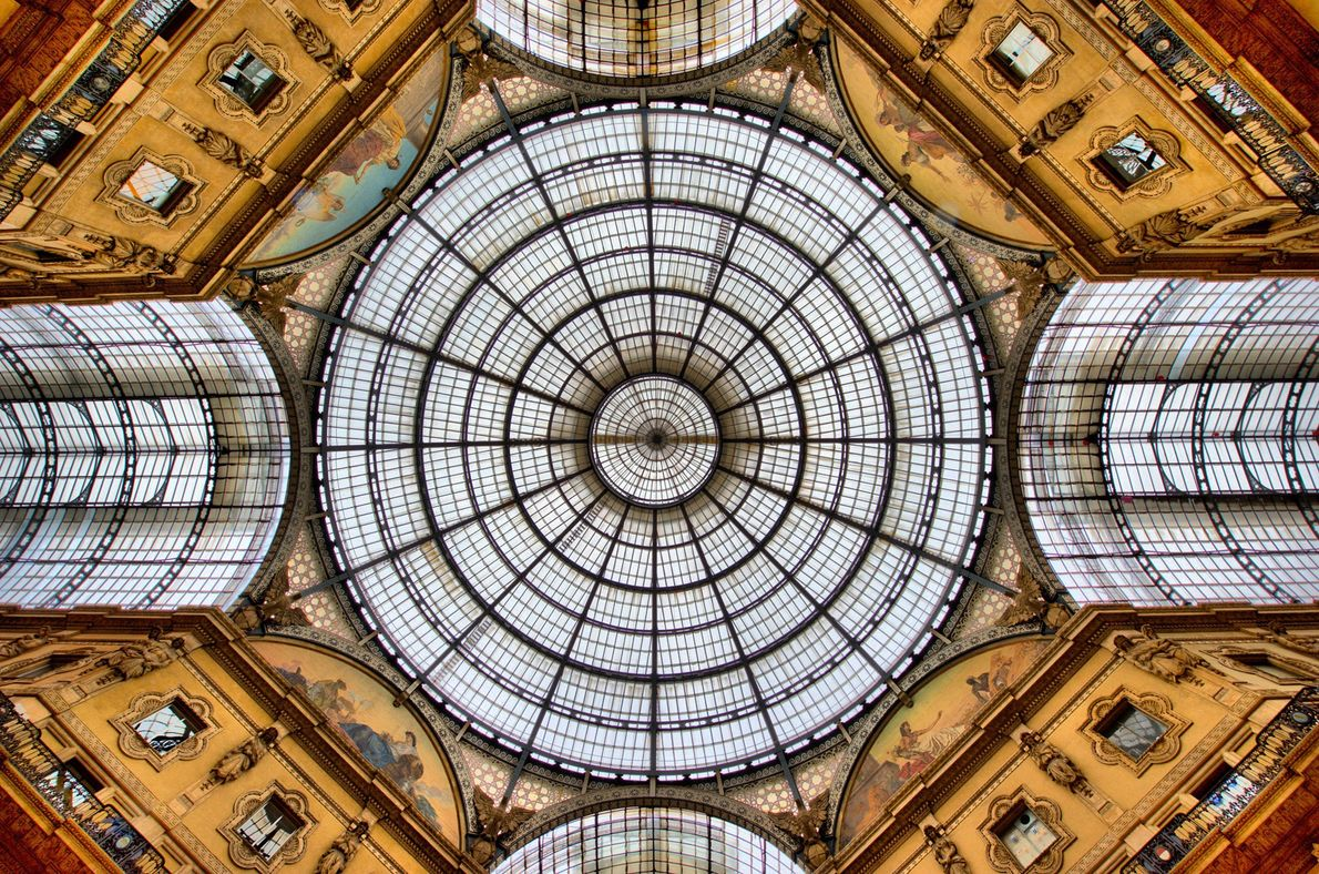 Light streams through the windows of the Galleria Vittorio Emanuele II, one of the world's oldest ...