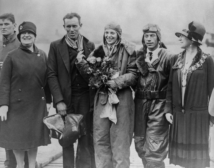 When the Friendship landed in the United Kingdom in 1928, Amelia Earhart (centre) captured the public's ...