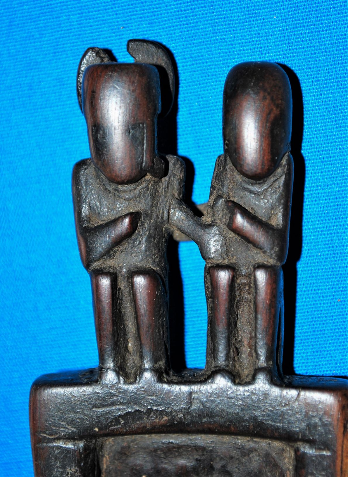Figurines decorate a carved wooden snuffing tablet from the Cueva del Chileno find.