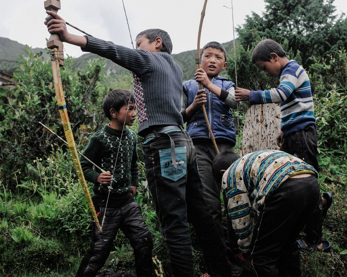 Archery is Bhutan's national sport. The pastime is enjoyed by young and old. Here, children practice ...