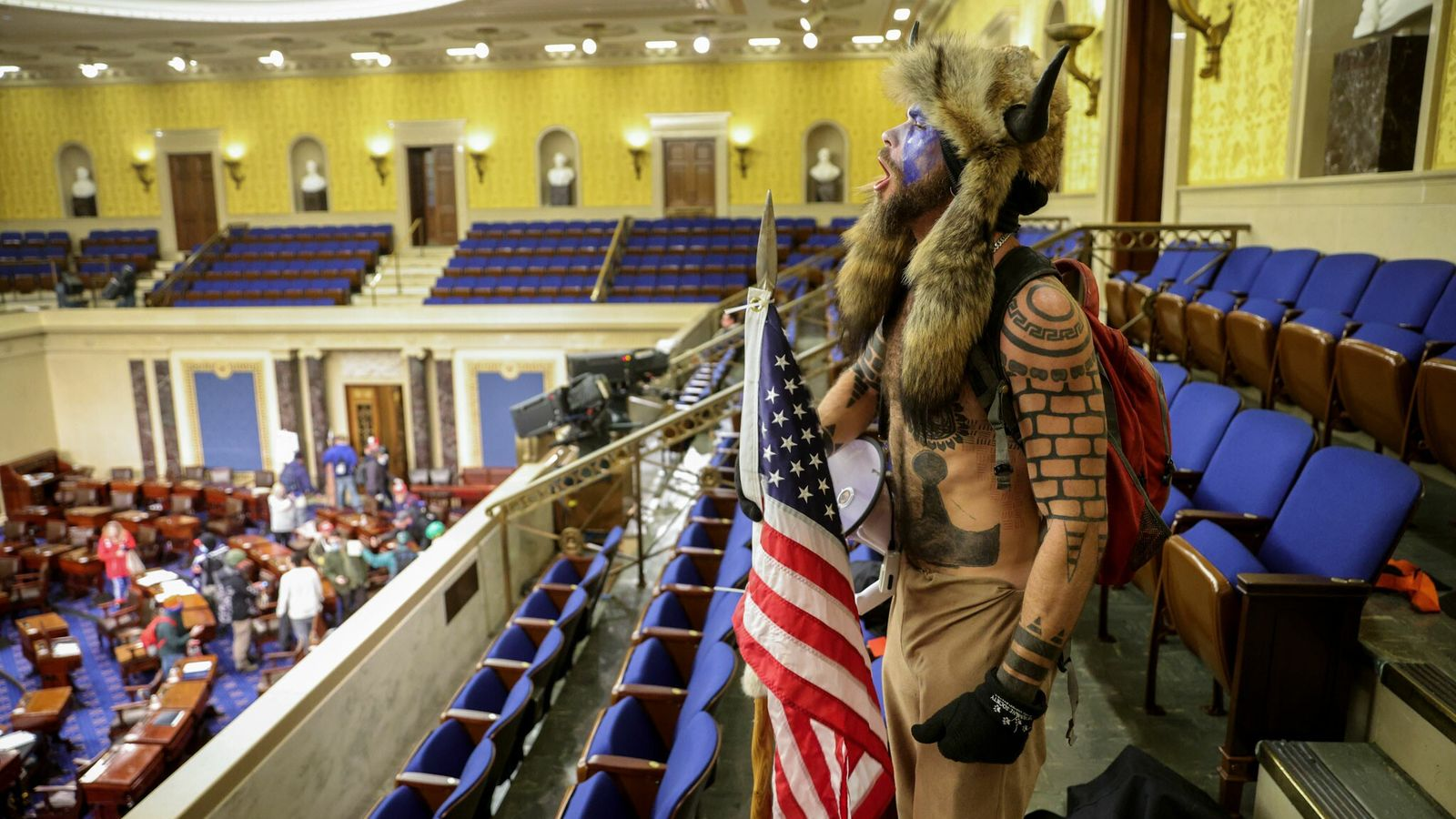 A Trump supporter entered the Senate Chamber as lawmakers and staffers were rushed to a secure ...