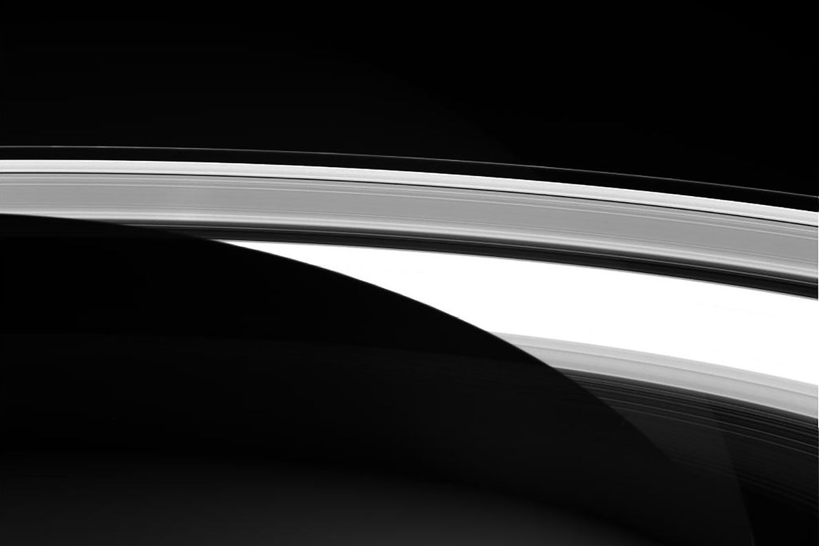 Saturn's wide but thin rings seem almost solid enough to skate across in this unprocessed picture ...