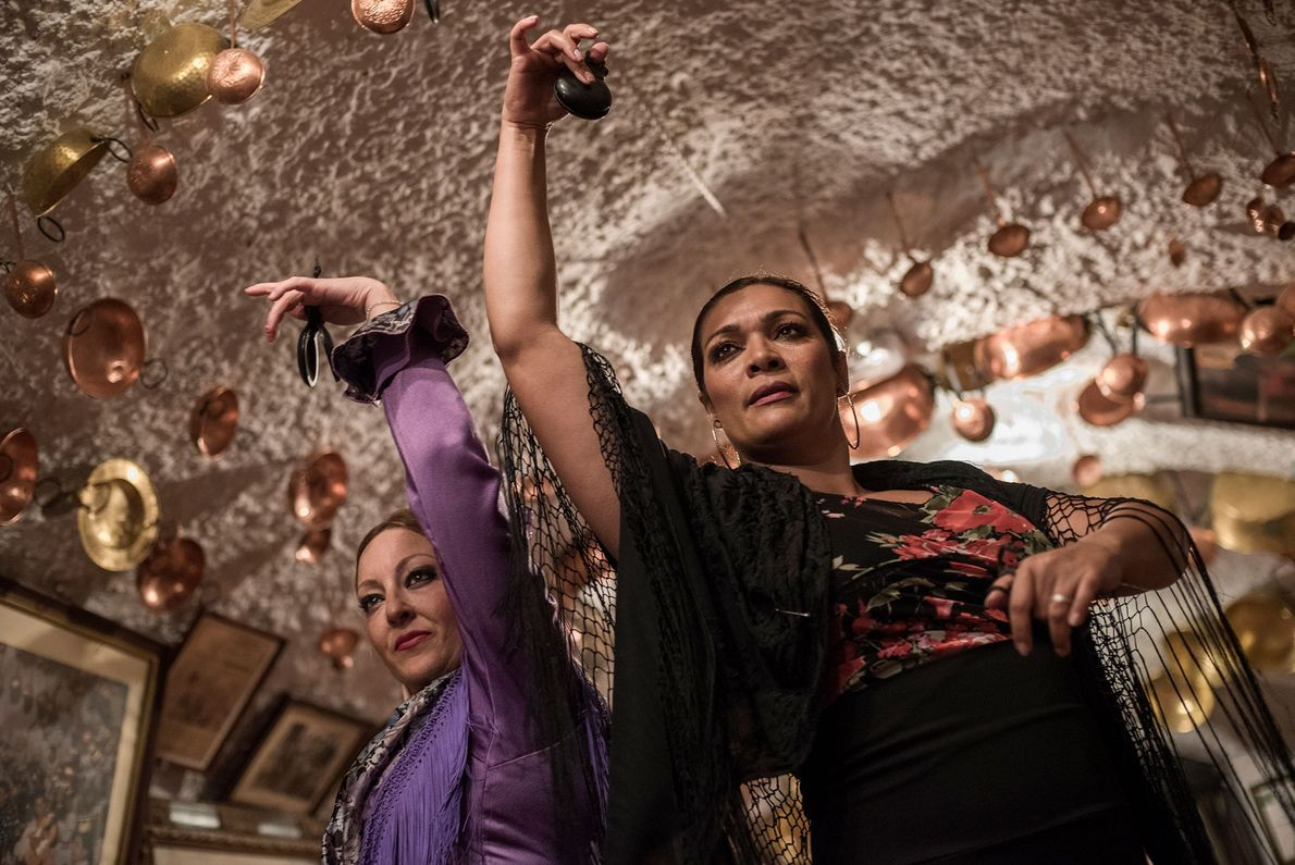 Two women dance flamenco in the caves of Sacromonte. The traditional Spanish dance was born in ...