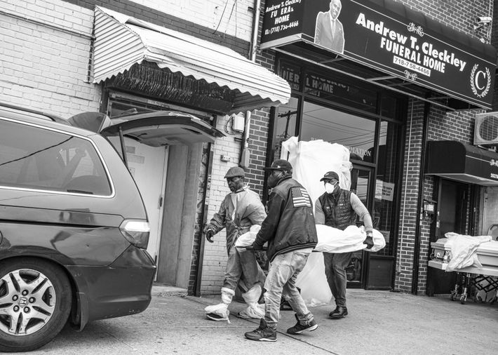 Bodies are moved from a minivan into the Andrew T. Cleckley Funeral Home in Brooklyn. The ...