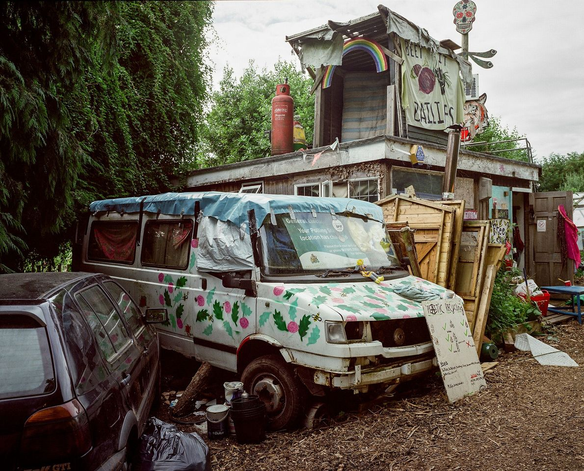 Salvaged items and vehicles—some decorated and some waiting to be used—sit on the Grow Heathrow site.