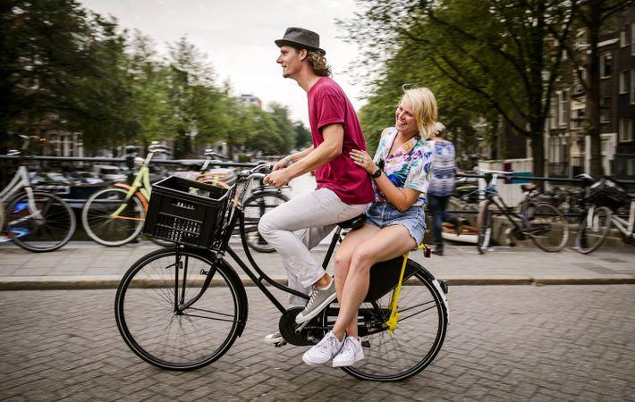 A tourist takes a free city tour through Dutch company Yellow Bike in Amsterdam.