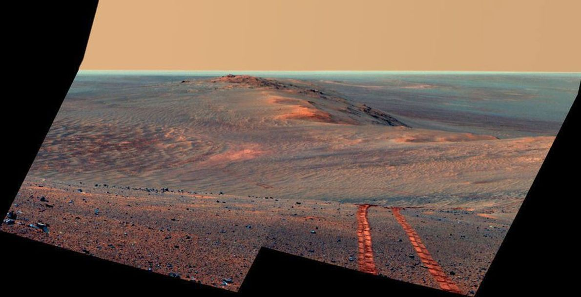 The panoramic camera on NASA's Mars Exploration Rover Opportunity captured this scene of the west rim ...
