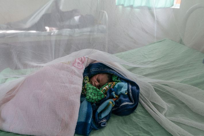 Mary's baby, named Monday, is tended to at a maternity ward inside a Northern Ugandan refugee ...